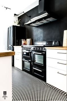 Love the shiny black vintage stove with the black and white cabinetry. We've seen a Smeg that will suit us well.