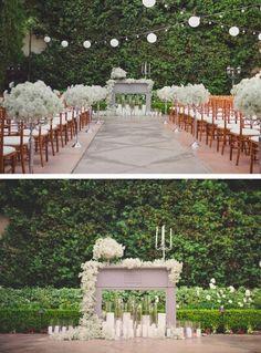 Outdoor fireplace mantel decor as wedding alter