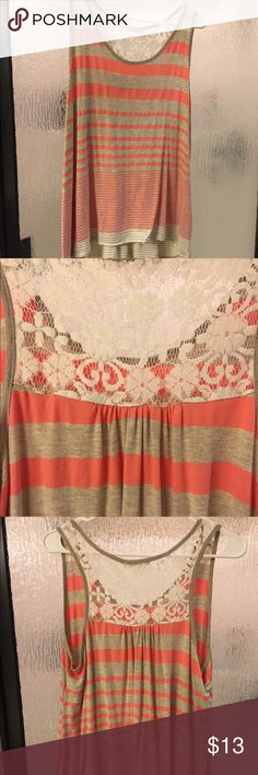 Tank with a lace back. BUNDLE AVAIL! Tank top with the back top of it being lace! I'd consider it a hi-low tank! Lelis  from Nordstrom Rack. lelis Tops Tank Tops