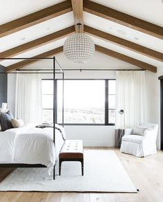Studio McGee Promontory Project Master Bedroom with vault and beams with steel look a like windows-1