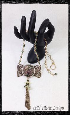 Handmade OOAK Chocolate Bow Tie Flower Cameo Assemblage Necklace - Bouquet of Flowers on Etsy, $55.00