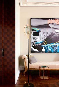 London home of Caroline Sarkozy >>> Au-dessus du lit de repos de Marc du Plantier acheté aux enchères chez Camard (Paris), tableau de John Baldessari, galerie Marian Goodman (Paris); lampadaire de Max Ingrand pour Fontana Arte, galerie Jacques Lacoste (Paris), et table en métal doré, galerie Anne-Sophie Duval (Paris).