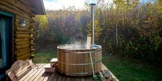 Go natural and make this wood and steel outdoor hot tub.