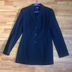 This is a black blazer or coat from express stretch and has three front buttons, long sleeves, an inside lining and is a Lycra, nylon, and rayon blend, freshly laundered