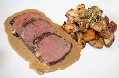 Juniper Roasted venison with rye whiskey cream sauce. That looks amazing! I love this blog. He uses wild game and other food her forges for and plates it up like a high class upscale restaurant.