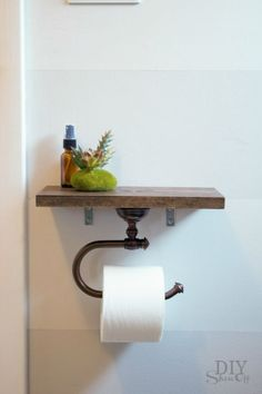 Toilet Paper Holder Shelf- Not only does this DIY toilet paper holder add extra storage space, it's also functional and chic. Get more DIY projects to improve your bathroom at redbookmag.com.