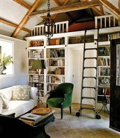 quaint library nook with a loft perfect for tucking away with a good book.  Via Kelly Mac