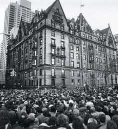 Outside Lennon's apartment building after his death.