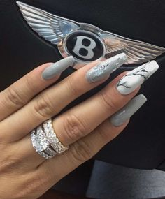 Ummmmmm sooo the ring and the car. I didn't even see this chicks nails until the last minute