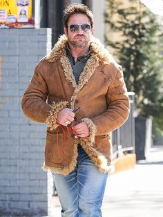 Star Tracks: Tuesday, February 18, 2014 | WOOLY MAN | Between his aviator shades and '70s-inspired outerwear, Gerard Butler looks more rock star than thespian while walking around New York City on Monday.