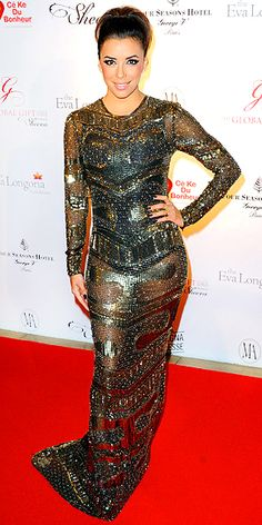 EVA LONGORIA  From the French Riviera to the City of Lights, Eva keeps the all-out glamour coming, attending the Global Gift gala in a dazzling sequined bronze Reem Acra dress and high pony.