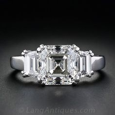 A 3.20 carat high quality Asscher-cut diamond is set in a tailored, classic platinum mounting. The diamond, which is accompanied by a GIA certificate which states G color, VS2 clarity, is set with four split prongs and flanked by perfectly matched trapezoid-cut diamonds. An outstanding ring! Currently size 6.