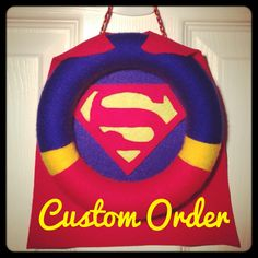 Superman wreath made with felt and yarn great for a boy's room :-)