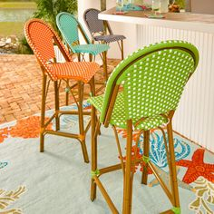Colorful and comfortable resin wicker patio furniture instantly updates a patio or deck. These high back outdoor bar stools are weather resistant and durable.