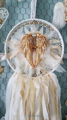 Royal Golden Wings This gorgeous dream catcher is my shabby chic version, but tattered and torn for more romantic vintage charm! Everything has been hand stitched together piece by piece, layer upon layer down to every tiny button, all lovingly stitched with vintage cream string.