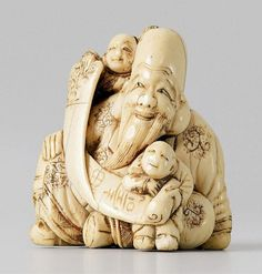"""A very impressive ivory netsuke of Fukurokuju with two karako, by Masatsugu. Early 19th century. Seated in a relaxed pose with one karako sitting on his shoulder, the other on his leg, both displaying a scroll with the two characters """"fuku"""" (good luck) and """"ju"""" (long life). The hair tufts of the children of black horn. Signed Masatsugu."""