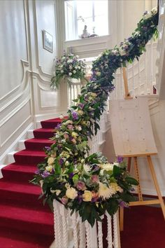 Outstanding staircase flower arrangement by award winning Classic Flowers and Events wedding florists, based in Kent, UK. They work with you to ensure you get the flowers / decor you're after for your special day! Wedding flowers - arrangements, summer, decorations, staircase, ideas