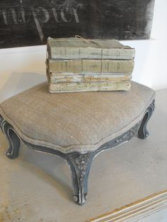 Little French footstool with antique French linen