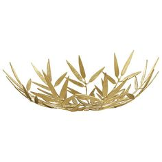 A strikingly beautiful decorative bowl inspired by bamboo leaves, made from brass. Use as a centrepiece on a coffee table or console. The ideal companion for our Zhu Lamp.