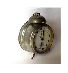 Antique clock. Alarm clock. Old metal by Underlyingsimplicity