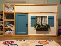 Ikea Hack: I converted Colette's KURA Reversible bed into a playhouse by adding a front panel with a window.  I just recently added the door, at her request :)