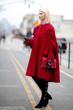 Street Style: 30 looks for January. Blush turtleneck sweater+red coat+black stud over the knee boots+red studded wristle bag+printed gloves. Winter Everyday Outfit 2017