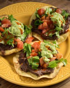 Baked Oil Free Tostadas [recipe, refried beans, tortilla, avocado, lettuce, tomato]