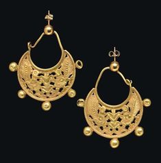 A PAIR OF BYZANTINE GOLD EARRINGS   CIRCA 6TH-7TH CENTURY A.D.   Each crescentic in form, with an openwork design of two stylized confronting peacocks on either side of a central palmette, the details incised, framed below by beaded wire, five hollow spheres soldered along the edge, the ear hoop joined to the concave edge, arching above, and hooked to a loop at one end; the hoop joined to modern gold balls and ear posts