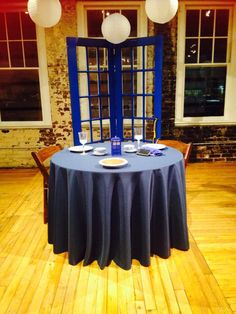 Doctor Who Wedding: Ceremony backdrop used as simple reception backdrop for sweetheart table.  Used heir  loom blue phoenix china and Tardis centerpiece.