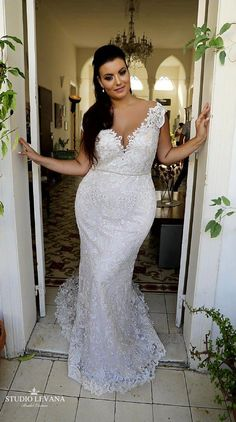 0b5a5d5364f2 Plus size lace mermaid wedding gown with deep cleavage. Adel. Studio Levana  Wedding Dresses