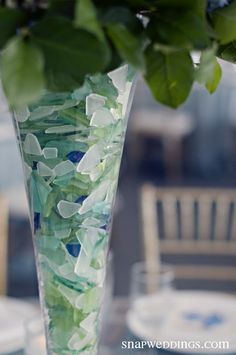 Using seaglass as a vase filler. More ideas here: http://www.completely-coastal.com/2009/02/sea-glass-love-decorating-craft-ideas.html