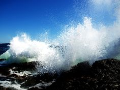 Waves crashing against the rocky Maine shore