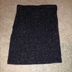 Black sparkly fitted skirt Beautiful black skirt with silver detailing through out it. Worn once but it's too small on me so it's in perfect condition. Purchased from pacsun. ❌ no trades PacSun Skirts Mini