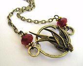 love the hunger games- doesn't really lend itself too much to fashion (unless skin dying has come about and i don't know about it), but i love this necklace...