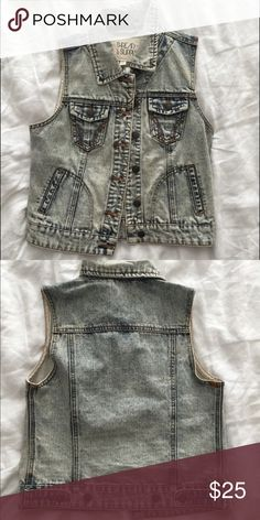 Jean jacket vest. This jean vest is marked size small and fits true to size. It has a light blue, almost acid wash look to it. Worn once. Thread and Supply Tops