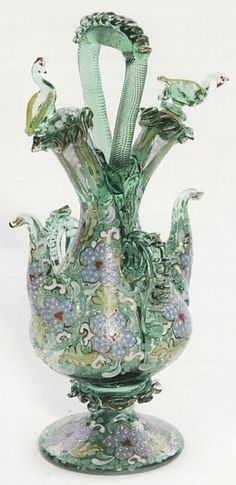 Moser glass, royo, handled double neck cruet with bird dtoppers, two spouts, pedestal form, overall polychrome enamel. Czechoslovakia, circa 1920-1240