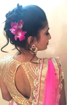 Indian bride's bridal reception hairstyle by Swank Studio. Find us at https://www.facebook.com/SwankStudioBangalore  #Saree #Blouse #Design #HairAccessory