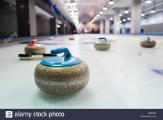 Download this stock image: Curling stones lined up on the playing field - G3C160 from Alamy's library of millions of high resolution stock photos, illustrations and vectors.