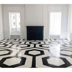 The design duo behind @kapitomullerinterior snaps a pic of groovy black-and-white geometric floors.