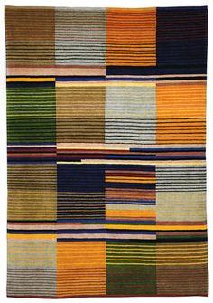 Handmade rug from Christopher Farr based on the original design by Gunta Stölzl for Bauhaus Dessau, 1928. Original at the V, London