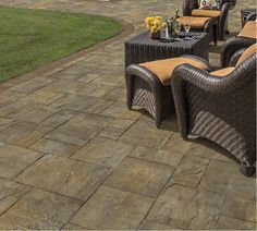 This beautiful patio was created using the Sherwood Collection, Ledgestone XL, 3-Pc. Design Kit in Toffee/Onyx. #cambridge #pavers #pavingstones #armortec #cambridgepavers #cambridgepavingstones #patio