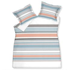 Bedding in various gradient shades of blue/turquoise stripes.