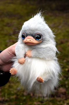 Platypus Approx 15 cm ( ~6) in length. - Completely handmade. - Solid parts are made of polymer clay. - Glass eyes. - Fully Posable. Wire skeleton. - Made from high quality Faux Fur. This is a collectors item and made for adults only. Will not be suitable for children. Can not be
