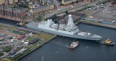 It's a tight squeeze as Type 45 destroyer HMS Duncan is guided through a lock into Cardiff at the start of the NATO Summit.