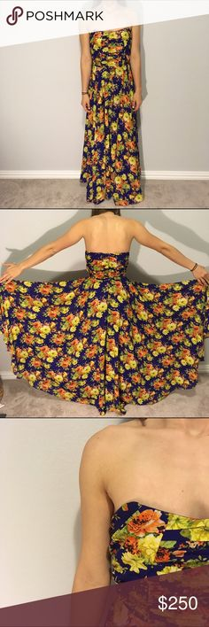 """Candela X Free People Kellen Formal Dress Floor-skimming sheer chiffon gown with a placed print in a whimsical rose design perfect for weddings, proms, or any formal event. Strapless sweetheart silhouette, with a pleated bodice and voluminous skirt. Hidden back-zip closure. Mini slip lining. I wore this once for my senior prom and have no use for it anymore, it is an absolutely beautiful dress. I am 5""""8 and a 32/34 B and the bust fits me nicely :) I bought this dress for $450 dollars but am…"""
