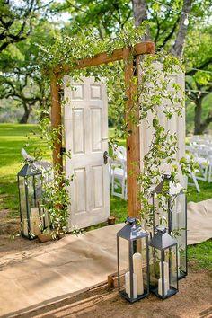 rustic wedding lanterns arch via the nichols / http://www.himisspuff.com/100-unique-and-romantic-lantern-wedding-ideas/9/