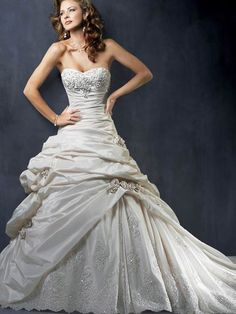 Found my dream dress<3<3<3 It's everything I've ever wanted in a wedding dress! I absolutely LOVE it!! Except, I would like something other than the flowers where the gathered fabric is!