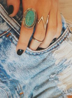 rings + black nail polish.
