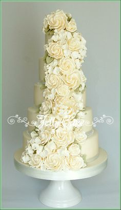 Ivory Rose Cascade Wedding Cake - Lots of ivory sugar roses, hydrangeas and a peony to match the wedding flowers.