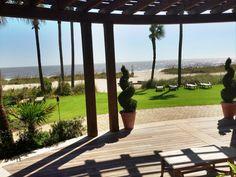 Soak up the sun while enjoying the incredible view. www.seaisland.com #seaisland #eventdesign #decor #outdoorevent #ocean
